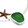 Detail of green sea glass slide.