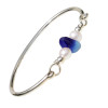 Vivid mixed blue beach found sea glass combined with real cultured pearls on this solid sterling silver  heavy round sea glass bangle bracelet.