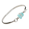 One piece of beach found sea glass in thick and perfect pure white on this solid sterling silver half round sea glass bangle bracelet. Soft aqua blue frosted beads make this a great choice for any beach wedding.