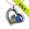 Our new heart lockets make this blue and green sea glass really shine! A tiny starfish completes the beachy look! Genuine beach found glass. Sorry this locket is no longer for sale.