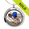 Blue sea glass pieces combined with a real starfish, tiny nautilus shells and a piece of vintage sea fan. Real beach sand completes the beachy look in this sea glass locket necklace. Sorry this locket has sold!
