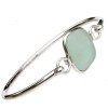 A beautiful piece of beach found seafoam green sea glass is set in our deluxe minimum bezel setting and comes on a round solid sterling bangle.