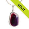 A mixture of vivid pink and purple are fused on top of this pure white sea glass piece from England. These mixed sea glass pieces are the remnants of art glass scraps being discarded into the North Sea. Beautiful and unusual sea glass set in our Original Wire Bezel© necklace pendant setting.