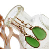 Nicely shaped piece of beach found sea glass in a classic gold earring.