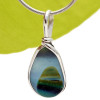 An amazing combination of 5+ Colors in a medium blue base in this very old English Sea Glass piece and set in our Original Wire Bezel© necklace pendant setting
