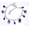 4 pieces of genuine beach found sea glass in a flashed blue and white combined with bright blue fire polished cobalt beads in a totally solid sterling silver bracelet.