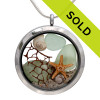 Genuine seafoam green sea glass pieces combined with a real starfish, a piece of sea fan, tiny shell, pearls and real beach sand in this JUMBO 35MM stainless steel locket.