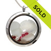 Pure white sea glass pieces combined with a real sand dollar, a pearl and pink tourmaline gems and real beach sand in this JUMBO 35MM stainless steel locket. Great gift idea for a cancer survivor!
