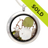 Vivid Peridot Green sea glass combined with a real sandollar, tiny beach shells, a pearl and beach sand and brightened up with a ton of crystal peridot gems.  Great choice for an August Birthday! Sorry this locket has been sold!