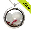 Pure white sea glass combined with a baby sandollar and beach sand in this twist top stainless steel locket necklace. SOLD - Sorry This Sea Glass Jewerly Selection Is NO LONGER AVAILABLE!
