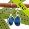 Deep rich mixed blue sea glass pieces from Seaham England are set in our Original Wire Bezel© earring setting. This is a very hard sea glass to match and this photo is true to color, subtle variances in the blue shade can be seen. Sorry - This Sea Glass Jewelry piece has been SOLD!