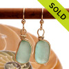 Vivid tropical aqua sea glass from Hawaii is set in our Original Wire Bezel© setting for a stunning pair of 14K gold filled earrings.  Sorry this pair of Sea Glass Earrings has been SOLD!