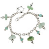 Vivid aqua green sea glass  with various green sea glass on a solid sterling silver charm bracelet. A kissing Dolphin Charm completes the beachy look.  ALL of our sea glass charm bracelets are on fully soldered chains with soldered utility links for a lifetime of surety and enjoyment.
