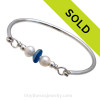 Vivid mixed blue beach found sea glass combined with real cultured pearls on this solid sterling silver FULL round sea glass bangle bracelet. Sorry this sea glass jewelry selection has been sold!