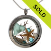 Tropical aqua Hawaiian sea glass is combined with a real starfish and pearls and a bit of vintage sea fan and beach sand in this one of a kind sea glass locket.  Vivid Aquamarine crystal gems bring in a bit of bling and make this a great specially those with a December Birthday! Sorry this sea glass locket has been sold!
