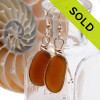 Genuine Brown Sea Glass Earrings in a classic gold bezel setting. Our Original Wire Bezel© setting leaves this natural beach found sea glass pieces UNALTERED from the way they were found on the shore. Sorry these earrings are no longer for sale