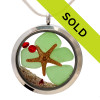 Green sea glass is combined with a real starfish and vivid red gemstones for a holiday inspired large sea glass locket. Sorry this sea glass locket necklace has been sold