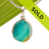 A stunning combination of vivid mixed vivid aqua  with a touch of bright gold in this very old English Sea Glass piece and set in our Original Wire Bezel© necklace pendant setting. Sorry this sea glass jewelry piece has sold!