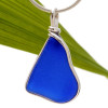 A large piece of cobalt blue sea glass set in our Original Deluxe Wire Bezel© necklace pendant setting.
