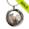 SOLD - Sorry this Sea Glass Locket is NO LONGER AVAILABLE! A white sun bleached sharks teeth and seafoam  sea glass, fresh water stick pearl and crystal gems in this fun to wear sea glass locket necklace.