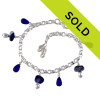 3 pieces of genuine beach found sea glass in a flashed blue and white combined with bright blue fire polished cobalt beads in a totally solid sterling silver bracelet.