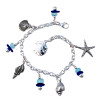 4 pieces of genuine blue beach found sea glass combined with aqua recycled glass beads in a totally solid sterling silver bracelet. Sealife Charms make this perfect for any beach lover!