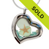 Tropical aqua sea glass and perfect seafoam green pieces combined with real pearls and a real starfish in a feminine heart shaped locket magnetic stainless steel locket necklace!