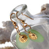 Perfect yellowy seafoam green sea glass pieces set with goldfilled sun charms for a lovely lightweight pair of earrings.