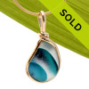 This is a stunning piece of perfect cross sectioned End Of Day Sea glass in electric teal set in our Original Wire Bezel© setting in gold. Sorry this one of a kind pendant has been sold!