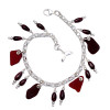 Vivid and Dark Ruby Red beach found sea glass  with  genuine garnet gem beads solid sterling silver charm bracelet. A Dolphin Tail Charm completes the beachy look.  ALL of our sea glass charm bracelets are on fully soldered chains with soldered utility links for a lifetime of surety and enjoyment.
