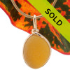 A once in a lifetime piece of large Golden Yellow sea glass is set in our Original  Wire Bezel© pendant setting in 14K Rolled Gold. This setting leaves the sea glass just the way it was found on the beach in England. Sorry this sea glass necklace pendant has been sold!