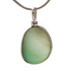 A subtle blend of greens in this 100 year old Victorian sea glass pendant.