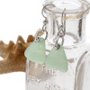 Natural seafoam green sea glass pieces are set with solid sterling details and are presented on sterling silver fishook earrings.