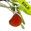 Vivid amber genuine sea glass piece set in our Original Wire Bezel setting in sterling silver. Shown here on our 2MM snake chain which is available as an upgrade. SOLD - Sorry this Sea Glass Pendant is NO LONGER AVAILABLE!