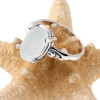 Natural surf tumbled sea glass in a simple sterling scroll ring.