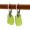A pair of natural surf tumble sea glass earrings in an unusual green on sterling leverbacks.