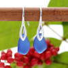 A pair of natural beach found sea glass earrings in a lucky cobalt blue on sterling silver deco hooks