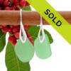 A pair of beach found Sea Glass Earrings in an vivid Green on Sterling Silver deco hooks. Sorry this sea glass jewelry item has sold!