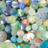 Most sea glass marbles are catseye marbles. They were machine made and widely used as children's toys for generations.