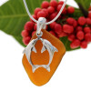 Beach found bright amber sea glass is combined with a solid sterling kissing dolphin and presented on an 18 Inch solid sterling snake chain.