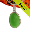 A nice piece of bright green sea glass in an elegant and versatile setting. Our Original Wire Bezel© pendant setting leaves the sea glass totally unaltered from the way it was found on the beach. Sorry this sea glass jewelry piece has sold!