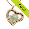 A stunning goldtone stainless steel locket necklace with seafoam green sea glass and a real sandollar and fresh water pearls. Sorry this sea glass jewelry piece has been sold!