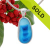 This sea glass is fused vivid blue inside a base of bright light blue.  It is set in our  sterling silver Deluxe Wire Bezel setting. Very Versatile and elegant. CLASSIC! Sorry this one of a kind sea glass necklace pendant has been sold!