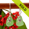 Natural green sea glass pieces are set with solid sterling  starfish charms and are presented on sterling silver  fishook earrings. Sorry these sea glass earrings have sold!