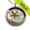 Genuine seafoam green sea glass combined with a real starfish, sea fan, pearls and real beach sand in this 30MM stainless steel locket. Sorry this sea glass jewelry piece has been sold!