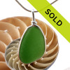 A perfect large piece of bright green sea glass in an elegant and versatile and original sea glass necklace pendant setting.  Sorry this sea glass jewelry item has been sold!