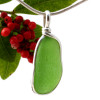 A nice piece of vivid Bright Green sea glass in an elegant and versatile setting. Our Original Wire Bezel© pendant setting leaves the sea glass totally unaltered from the way it was found on the beach.