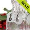 Rounded pure white sea glass earrings in sterling with sterling flip flop charms. SOLD - Sorry these Sea Glass Earrings are NO LONGER AVAILABLE!