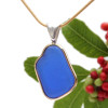 A perfect top quality piece of cobalt blue sea glass set in a mixed metal gold and sterling silver necklace.