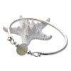 A thick piece of off white sea glass combined with sterling beads on a solid sterling bangle bracelet.